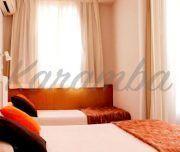 Habitación con camas en el Hotel San Remo
